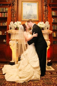 Kissing in front of fireplace