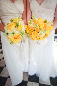 brides together with flowers